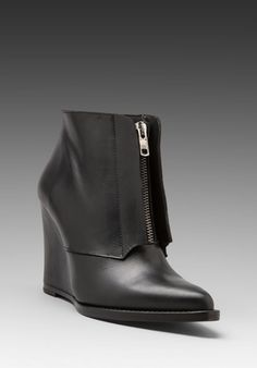 SURFACE TO AIR Buckle Bootie in Black -