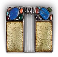 Joseph Hoffmann - Brooch. Gold-Plated Silver and Semi-Precious Stones. Made by Wiener Werkstätte. Circa 1905. 5.2cm x 5.2cm.