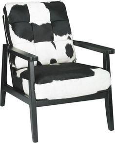 Mit diesem Sessel aus echtem Rindleder beweisen Sie individuellen Stil: Die schwarz-weiße Musterung des Leders ist aufregend und wird mit Sicherheit die Blicke Ihrer Gäste auf sich ziehen. Durch die naturbelassene Oberfläche ist der Sessel besonders authentisch. Das schwarze Eichenholz unterstreicht den mondänen Look des Leders. Dank der Polsterung mit Schaumstoff ist der Sessel auffallend schön und zudem sehr bequem. Ein gutes Buch und ein Glas Wein werden
