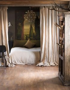 A wall of curtains creates a theatrical point of entry for this bedroom, designed by UXUS, and sets the stage for the dramatic design beyond. Via French by Design. Apartment therapy