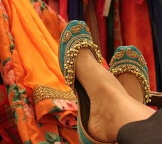 turquoise juttis, ghungroo work, gold ambis print