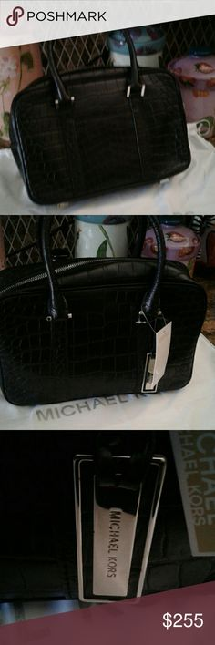 Michael kors collection handbag. Best offer Lovely Silverton collection. Black croco leather with chrome accents. Used 3 times on vacation. Original dust bag and detachable shoulder strap included. Like New. Part of the tag is still attached. No flaws. As seen on Heidi klum. Accepting offers. Will consider trade for similar priced bag .any color but black. Too many. Michael kors collection Bags