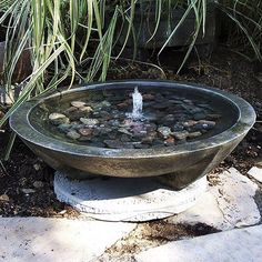 This simple fountain design establishes balance and is very pleasing to the eye with its exquisite colored rocks. Comes with concrete pad. Perfect Garden Fountain for your patio!