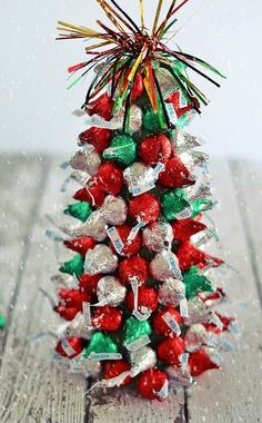 """Kiss""-mas Tree Centerpieces In the holiday spirit for a festive centerpiece, but aren't super crafty? These ""Kiss""-mas Tree Centerpieces made with Hershey's Kisses are . 3d Christmas Tree, Winter Christmas, Christmas Wreaths, Christmas Holidays, Christmas Decorations, Classy Christmas, Primitive Christmas, Country Christmas, Christmas Christmas"