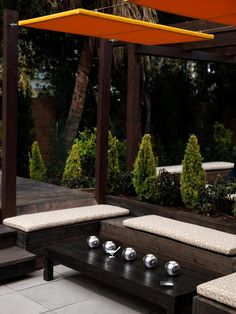 """These sliding canvas panels (from Jamie Durie """"HGTV:"""" http://www.hgtv.com/design/outdoor-design/outdoor-spaces/make-shade-canopies-pergolas-gazebos-and-more-pictures) are mounted and slide the same way as the fabric ones above.   There are eye hooks mounted on the frame of the panels, and the wire cable slides through the hooks, over the top of the panel. These can be moved to cover different areas of the space as the sun moves."""