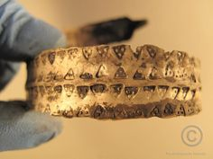 Viking bracelet found in Reykjavík. The bracelet is made from silver, approximately 6 cm high and 1.5 cm wide. It is only about 0.5 mm thick.