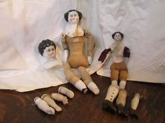 Small doll has broken hand and leg. Material around breast plate is glued can not remove. Good for display of rare dolls. Parts great for repair or jewelry. Lot of 10. China doll arms and legs. 1 arm and leg seem to be a bisque or clay. | eBay!