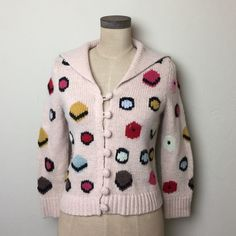 Fun Anthropologie licorice candy cardigan Fun print!  Crochet knit covered buttons. Wool/nylon blend pale peach color Anthropologie Sweaters Cardigans