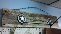 western style towel rack with barbed wire hanger and painted, naturally distressed cypress  barnwood backing. very nice piece for any western bath or kitchen decor. $19.99!
