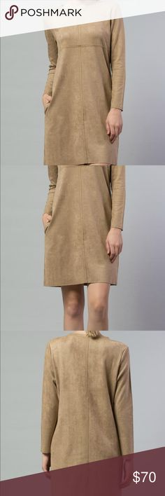 """Joh Faux Suede Long Sleeve Shift Dress NWT M Joh Faux Suede Long Sleeve Shift Dress with Pockets, Size M, New with Tags  Details: This tunic dress has dolman sleeves, raw edge seam detail and side seam pockets.  The khaki fabric is a stretch faux suede. Such a sophisticated look and so versatile -  wear it as a dress or as a tunic with leggings.  92% Polyester/8% Spandex Hand Wash or Dry Clean  Measurements: Length: 35"""" Bust: 42"""" Waist: 40"""" joh Dresses Mini"""