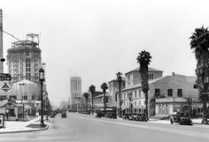 We're looking west along a sedate Wilshire Blvd, where parking isn't a problem and nobody had to allow time for traffic or check for Sigalerts. On the left, the Pellissier Building is under construction, which dates this photo to 1930. The Pellissier houses the magnificent Wiltern Theater which at the time it opened was designed as a vaudeville house and called the Warner Brothers Western Theater.