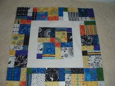 I like how she sashed disappearing 9-patch blocks with white. Gonna have to try this.