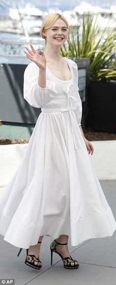 Fashionista: Elle certainly dressed to make a statement in a plunging white Victoria-inspi...