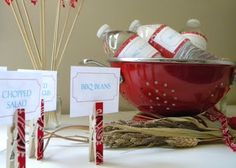 More BBQ ideas: Scrapbook clothespins used to hold menu cards and labels for water! Very inexpensive!