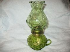 """VINTAGE L E SMITH 12""""  MOON AND STAR GREEN GLASS FINGER OIL LAMP. MOST OF THESE OIL LAMPS WILL BE THE CENTERPIECE OF MY DINING TABLE"""