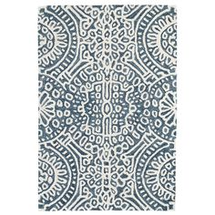 Build a cozy and welcoming sanctuary with this micro-hooked wool rug. Featuring a pattern reminiscent of stained glass on a dark blue background, this area rug brings a bit of serenity and spirit to any space it inhabits.