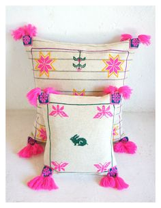 One of a kind Wixárika/Huichol hand-embroidered wool pillow with hot pink pom poms (( Mexchic & Tawexikta Embroidery Project )