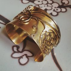 """@hoppedupjewelry """"One of the works in progress on the bench today...a wide brass cuff with stainless hop flower detailing. Can't wait to see how it turns out!…"""""""