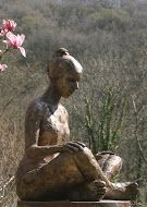 Sitting Figure by Carol Peace. A life-size outdoor figurative sculpture. Lifesize 85h x 62w x 64d cms Edition of 9 in Bronze resin