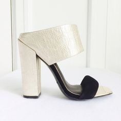 """Rachel Zoe Skyla Chunky Heel Mules The """"it"""" shoe of 2016 Rachel Zoe Skyla chunky heeled mules in gold and black. Currently on Revolve.com for $295 but sold out in all but one size. New and unworn with a few minor marks on the sole from being in my closet (nothing that can even be seen while worn, see pics). Size 5. Rachel Zoe Shoes"""