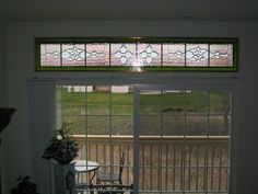 Custom Transom installed above Patio Doors. Designed and created by artist Kim P. Kostuch at Studio One Art Glass