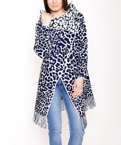 Polkadot Saxon Blue & White Leopard Mock Neck Cardigan | zulily . $19.99 $76.00 size: size chart One Size Product Description:  Encircle yourself in warmth with this cowl neck cardigan. A leopard sits camouflaged in allover leopard print.  Size note: This item runs in European sizing. Please refer to the size chart.      Fits sizes 4 to 10     100% acrylic     Hand wash; dry flat     Imported