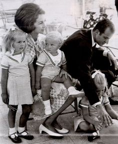 Queen Sofia and King Juan Carlos of Spain with their 3 children, left to right, Infanta Cristina, Infante Felipe, and Infanta Elena.  Note Sofia's hairdo.  I'm glad the '60's are over with!