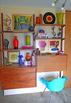 Outstanding mid-century wall unit and collection. via