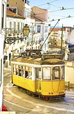 7 Days in Portugal Itinerary | Wooden trolley car navigating the streets of the Alfama district.