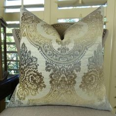 The front fabric of this exquisite contemporary throw #pillow is a blend of rayon, polyester and cotton in white and brown colors. Available at $ 105.00