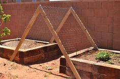 trellis across raised beds (more room for the beds and adds a pretty little 'tunnel' under the future plantings!