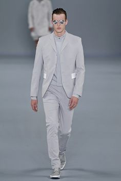 nice and grey. simple and straight cut with four buttons, short collar and white applications. Hugo Boss SS13 BERLIN FASHION WEEK