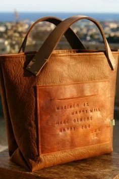 leather bag with embossed quote - very nice idea!