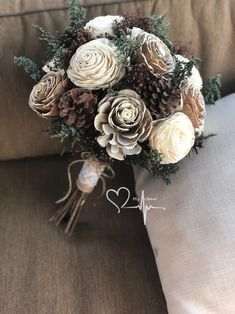 Woodland pine cone sola bouquet rustic winter bouquet ivory and brown green caspia dried wedding flowers round gathered stems bouquet 20 fall wedding hairstyles with flowers Pine Cone Art, Pine Cone Crafts, Pine Cone Decorations, Christmas Decorations, Pinecone Wedding Decorations, Decorating With Pine Cones, Flowers Decoration, Christmas Ornaments, Sola Wood Flowers