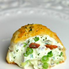 Bacon Cream Cheese Bombs Recipe Appetizers with refrigerated biscuits, cream cheese, bacon, green onions, grated parmesan cheese, cheddar cheese, garlic salt