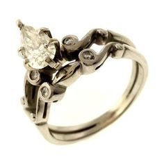 1.08ctw Pear and Round Brilliant Cut Diamond Ring in 14K White Gold http://www.propertyroom.com/listing.aspx?l=9628770