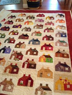 Offset houses quilt - by ?, via quilterblogs   ...Like the bus and flag at the schoolhouse...     ...couldn't find the exact link...