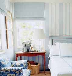 Baby Boy Blue @Elizabeth Sauer, light blue and white stripe wall, red table, blue floral chair, blue roman shades, corner windows