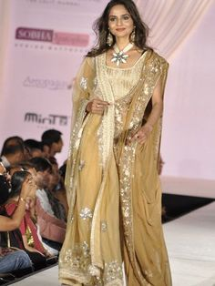 Madhoo in a beige layered sari by Shaina NC. That pendant in full bloom and those huge earrings are somehow over the top!