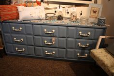 Fabric decoupaged to the top of this vintage dresser.