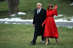 Off to Mar‐a‐Lago, March 17  -    Melania sported a custom‐made red coat designed by Alice Roi with gloves and leather belt to match. She accessorized with her favorite  Gucci sunglasses.