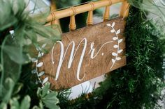 Wooden wedding chair decor - elegant wedding chair decor with white calligraphy and nature motif {Skys the Limit Photography}