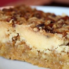 Pumpkin Crunch Cake: 1 box yellow cake mix 1 can (15 oz) pumpkin puree 1 can (12 oz) evaporated milk 3 large eggs 1½ cups sugar 1 tsp. cinnamon ½ tsp. salt 1½ cups chopped pecans (the original recipe called for ½ cup) 1 cup butter, melted