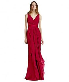 This sultry figure-elongating gown not only offers dramatic effect for a black tie wedding, but it can also be repurposed for a multitude of occasions year-round. Come fall, simply add a sparkly belt and a faux fur stole or scarf. Available in 38 colors.