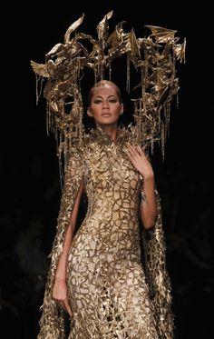 A model presents a creation by Indonesian designer Tex Saverio during Jakarta Fashion Week, November 18, 2011.
