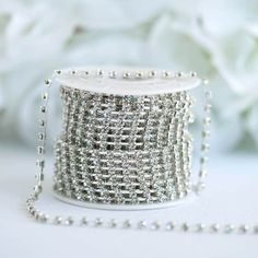Spruce your Favors and Crafts Up with efavormart's Sparkling Line of Decorative Rhinestone Diamonds. Shop for Diamond Trim Rolls to decorate Centerpieces, Dresses, Vases, and DIY Projects. Burlap Ribbon, Diy Ribbon, Wholesale Ribbon, Ribbon Decorations, Silver Diamonds, Cuff Bracelets, Sparkle, Chain, Gifts