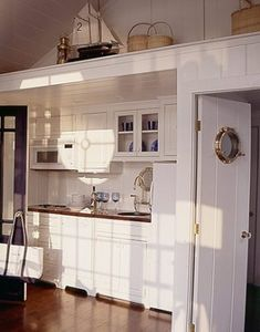 Subtle accents, like a porthole window in the kitchen door, and seaworthy knickknacks along a high ledge. The result? A yachty interior that makes you feel like you're on the deck of a boat. Beach Cottage Style, Coastal Cottage, Beach House Decor, Coastal Living, Coastal Decor, Coastal Entryway, Modern Coastal, Beach Condo, Coastal Furniture