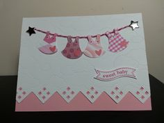 A cute baby girl card using the Stampin' Up Owl Punch. The border on the bottom was created using a Creative Memories border maker.