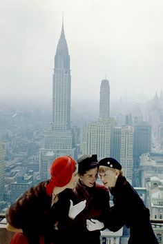 Models photographed by Norman Parkinson on top of the Conde Nast building on Lexington Avenue, New York, 1949