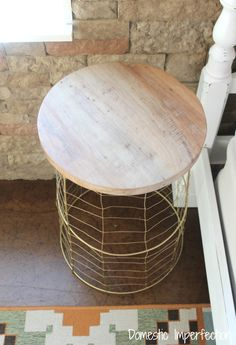Accent tables made made from tomato cages, wire, spray paint, and wood.